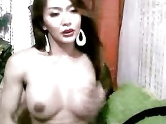 oriental ladyboy plays with her pounder
