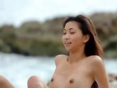 oriental gal pose by the ocean