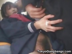 oriental schoolgirl cook jerking in a bus!