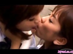 schoolgirls giving a kiss in locker room