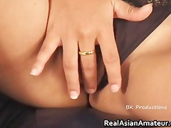 small oriental wench sliding sex toy on her part10