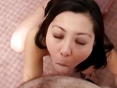 cute oriental brunette hair lady gives a hard bj