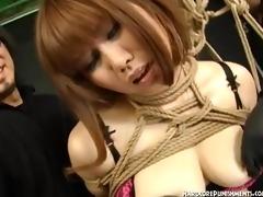 japanese sadomasochism bondman suspended in rope