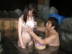 oriental gal in swimsuit giving oral-sex in the