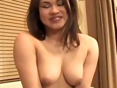 a floozy with diminutive mangos smiles nude at