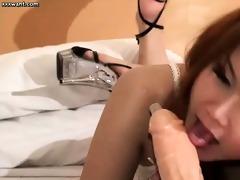 redhead shemale engulfing a dildo