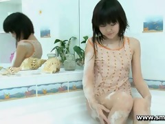 cute young asian aliona plays alone in the