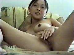 small oriental masturbates with comb