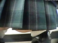 mini-skirt gals crouching down