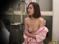oriental babes spied on during a breast exam