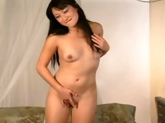 oriental babe plays with her wet crack -