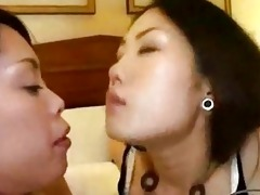 oriental girl giving a kiss spitting getting her