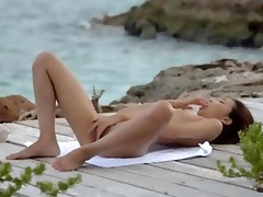 japanese girl teasing by the ocean